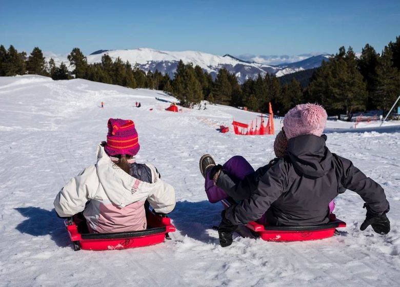 Tobogganing at the Nordic area of Beille